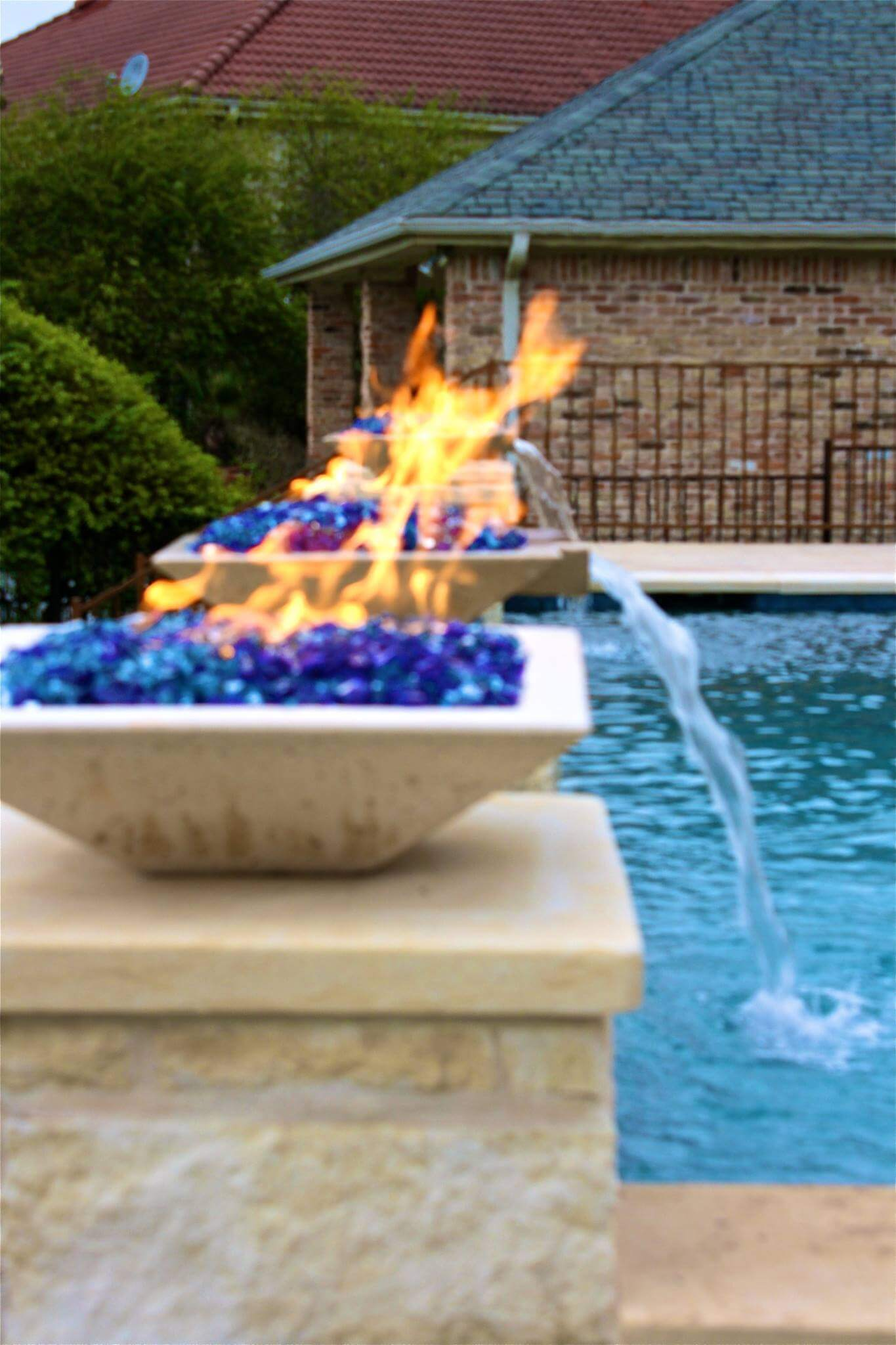 Backyard Fire Features in Inground Pool - Austin Pool Builders
